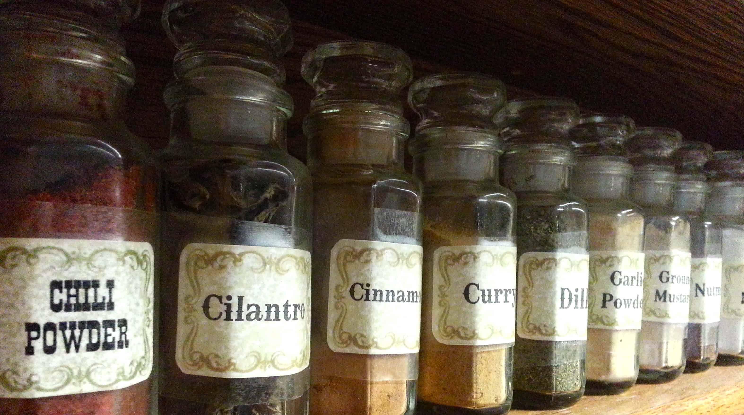 spice jars on a wooden shelf